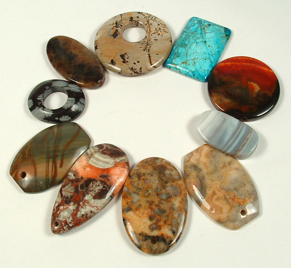 10 Jasper and Agate drilled stones to be used as pendants.