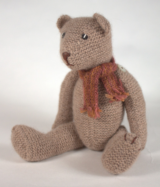 Miniature knitted teddy bear