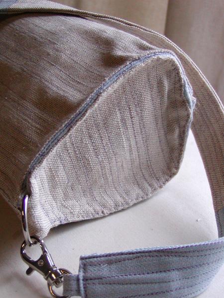 Purple stitched purse