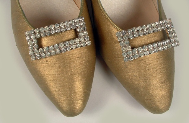 Close-up photo of shoe buckles.