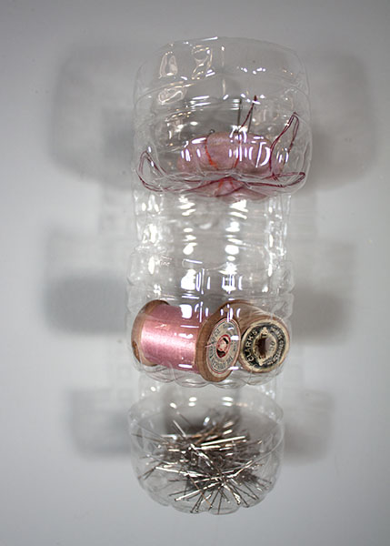 Three-tier plastic bottle organizer