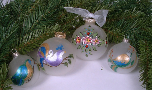 Photo of painted bird ornaments.