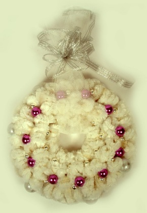 Photo of white Christmas wreath.