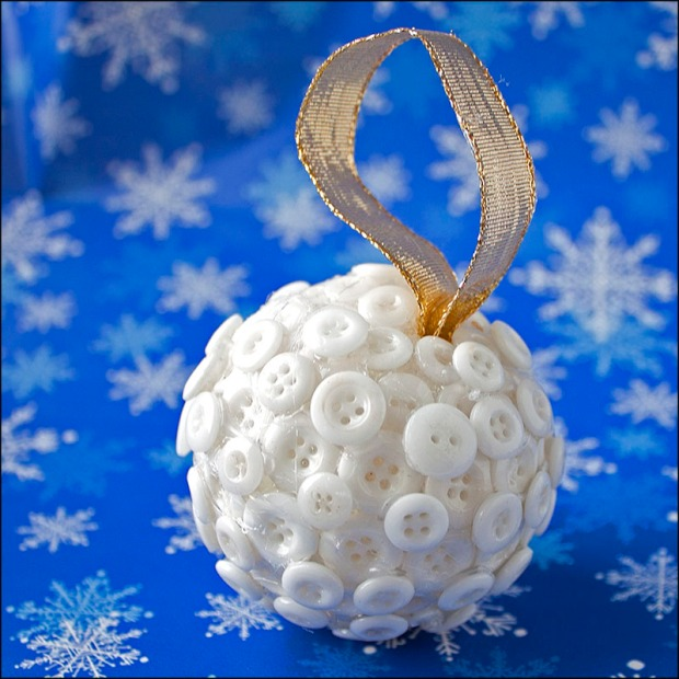 Styrofoam ball covered in small white buttons.