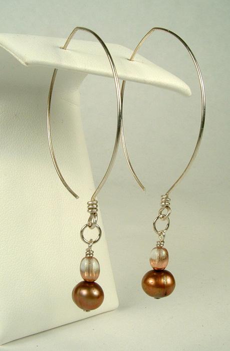 Brown pearl dangles on almond shape earwires.