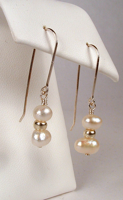 White pearl dangles on drape style earwires.