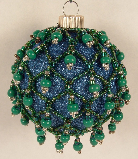 Glass ball covered in beaded mesh.