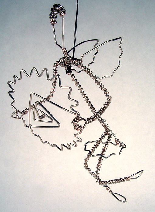 Wire-wrapped snow fairy holding a snowflake.