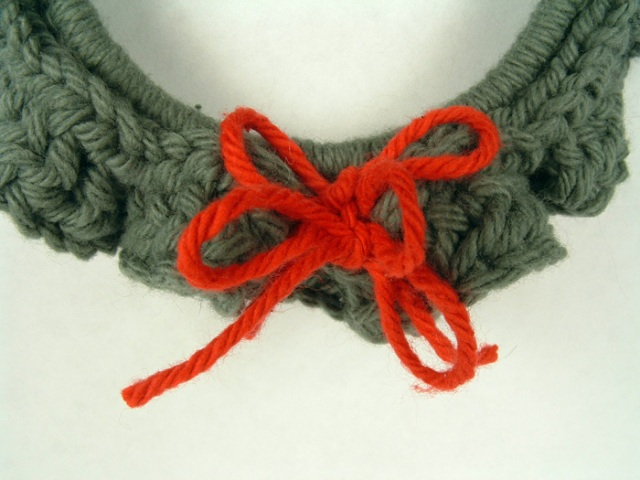 Close up of bow in wreath ornament.