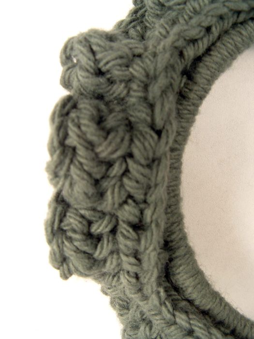 Close up of crochet stitches in wreath ornament.