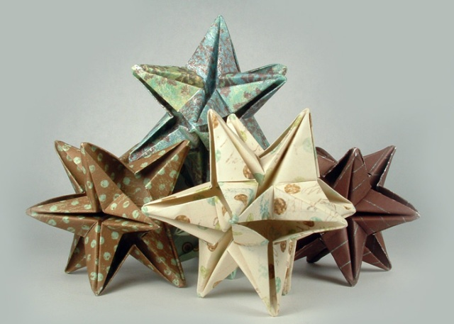 Origami 12 point stars made from scrapbook paper.