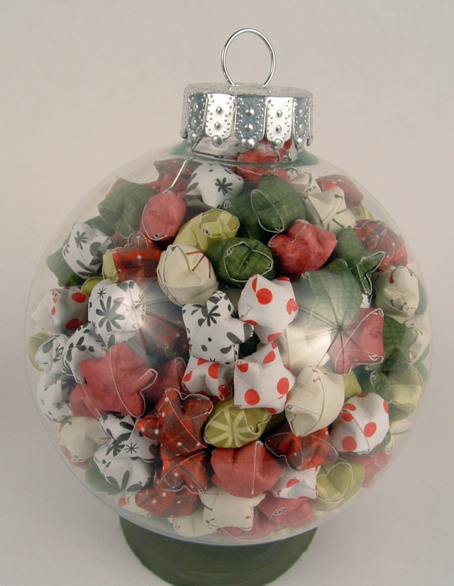 Glass ornament full of lucky stars.