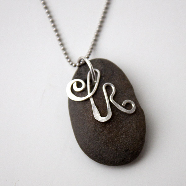 Rock pendant necklace and initial.