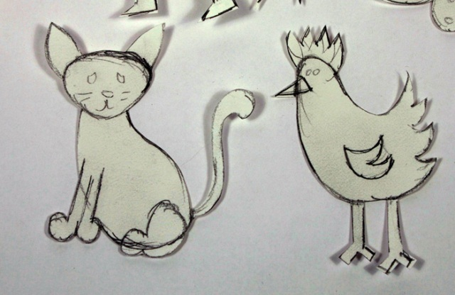 Close-up of cat and chicken drawings.