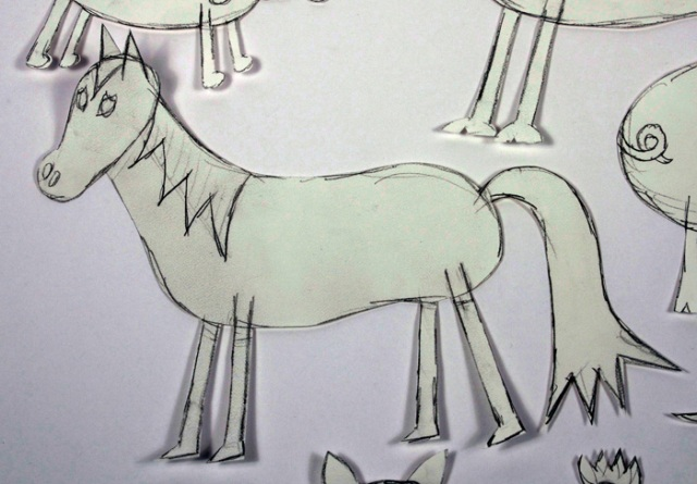 Photo of preliminary drawings of horse.