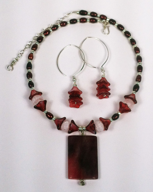 Almond ear wire earrings and matching necklace with pink pendant.