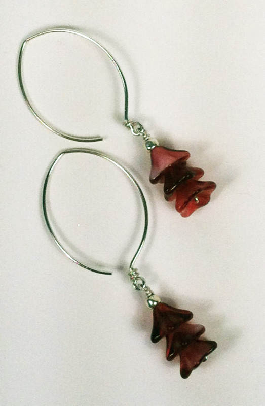 Almond ear wires with pink conical beads.