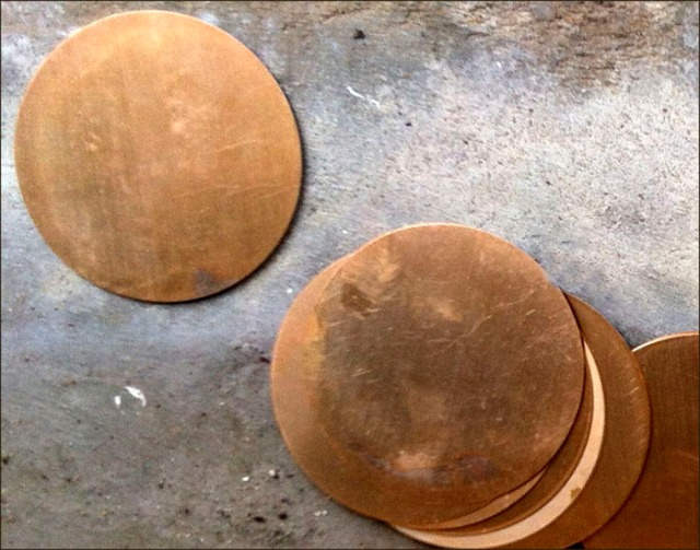 One pile of copper discs fanned out.