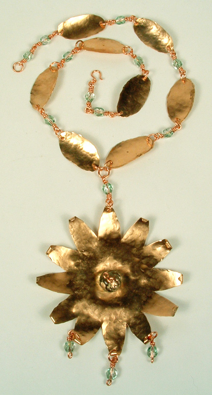 Copper star-burst pendant and leaf chain.