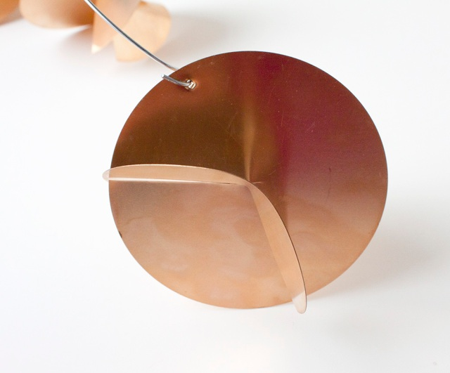 Round copper mobile shape