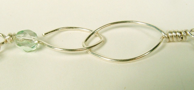 Almond shaped sterling silver clasp.