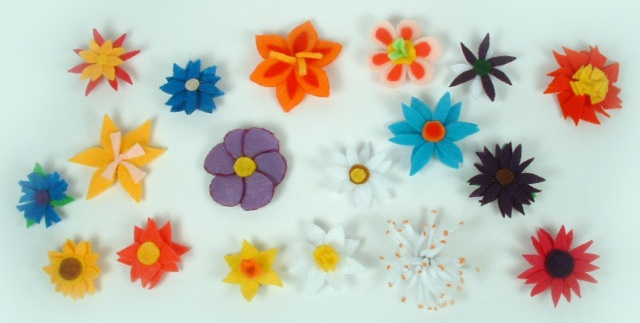 Overhead view of all 18 felt flower magnets.