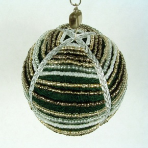 Thread ball draped with glass seed beads sewn into ribbon.