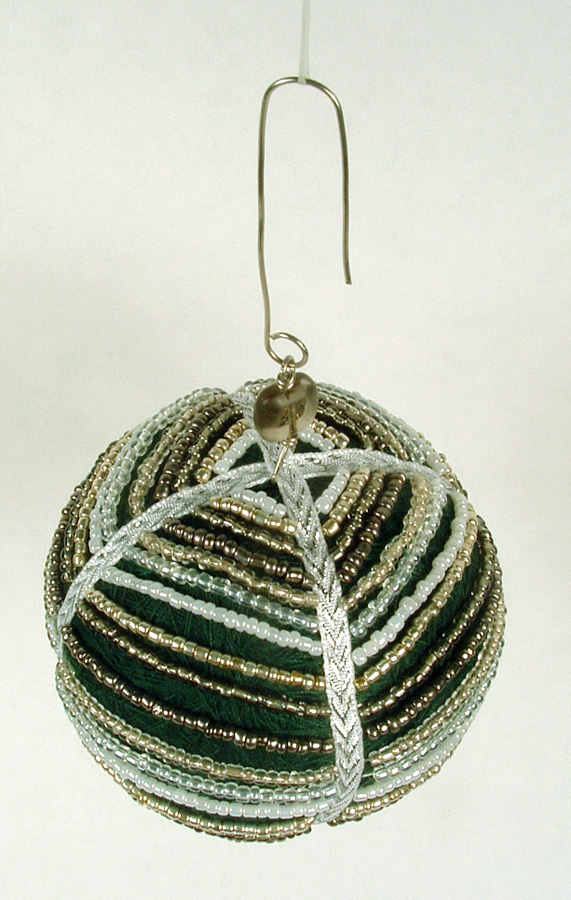 Thread ball draped with seed beads