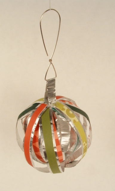 Ball ornament made of strips of paper and aluminum foil.