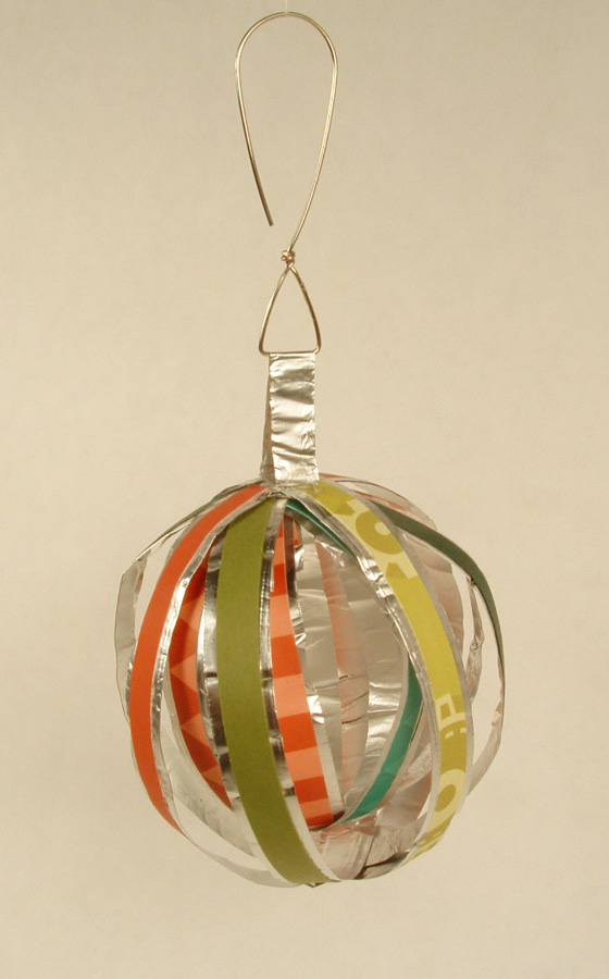 Ball Christmas ornament made of strips of paper and aluminum foil