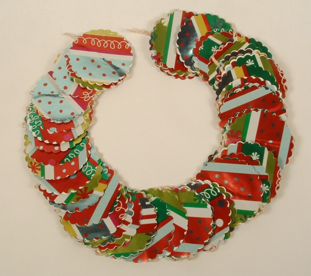Christmas garland made of Christmas wrap and shaped into a wreath.