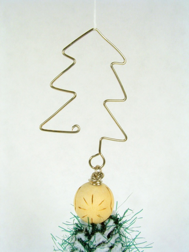 Ornament hook made to look like a Christmas tree.