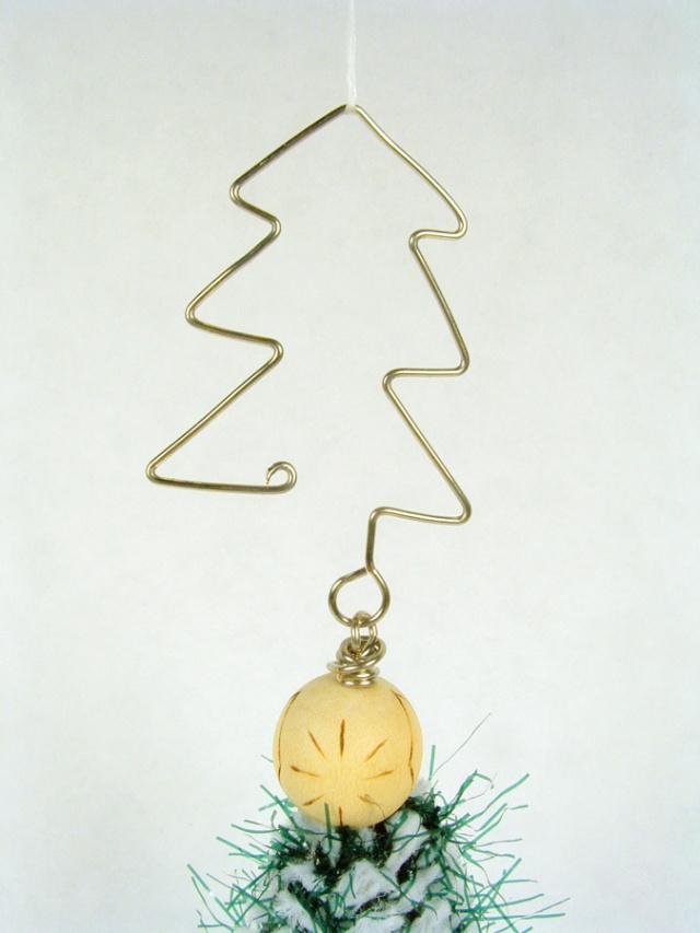 Ornament hook made to look like a Christmas tree.