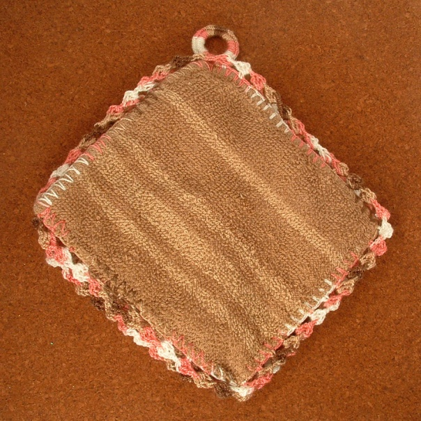 Completed hotpad made from a washcloth and crochet