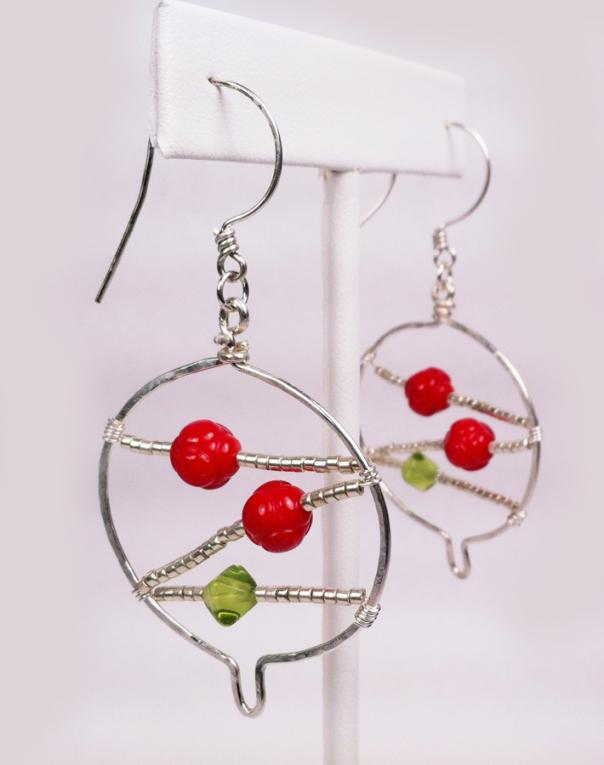 Close up of Christmas ball earrings.