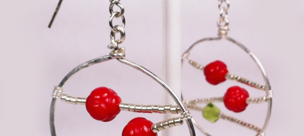 Close up of Christmas ball earrings.