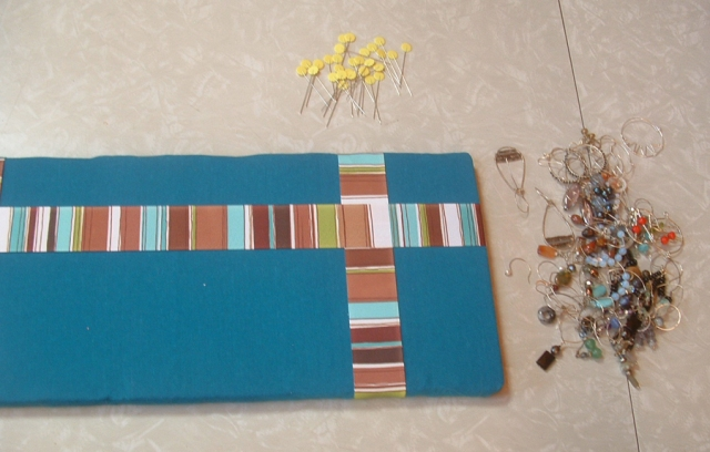 board, earrings, and pins all ready to be put together