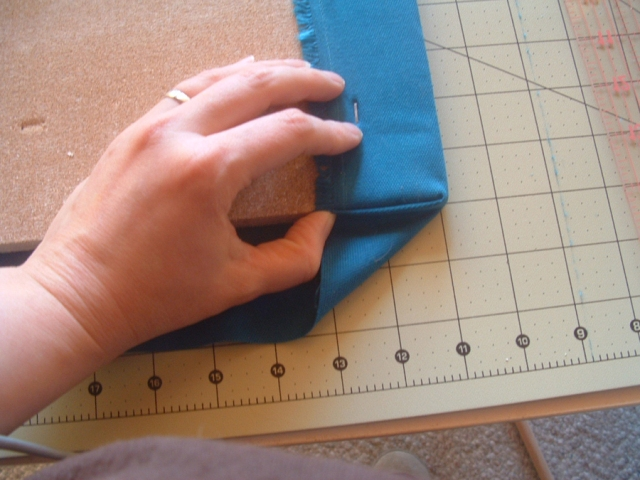 First step in corner fold.