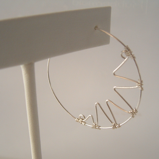 close up of the sterling silver zigzag hoop earrings