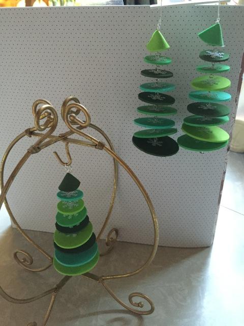 Three green foam tree ornaments.