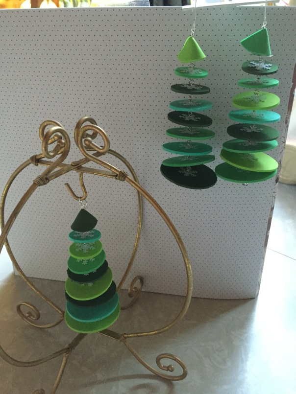Three green foam tree ornaments.
