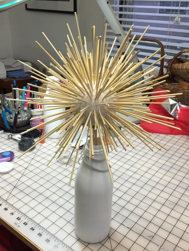 Styrofoam ball with lots and lots of bamboo skewers stuck through it.